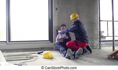 Accident of man workers at the construction site. A builder...