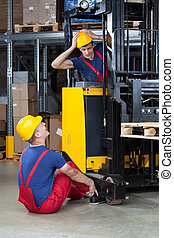 Accident on a forklift - Vertical view of an accident on a ...