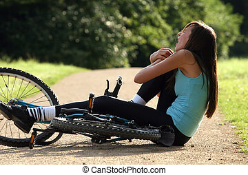 accident on road with biker - Female bike rider takes a...