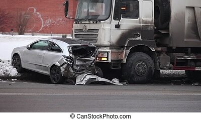accident on slippery road - collision of the truck and car