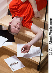 Accident on stairs - Young man having serious accident on ...