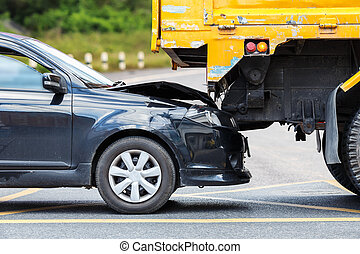 Accident on the road involving black car and yellow truck