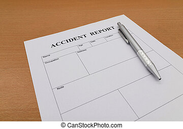 Accident report form with pen on table