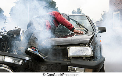 Accident - Severe accident between a motorcyclist and a car,...