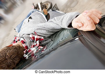 Accident - Motorcyclist lying unconciously on the windscreen...