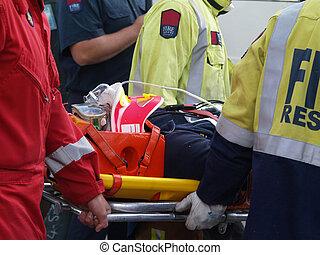 Accident Victim - The paramedics & fireman carrying an...