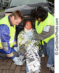 Accident victim - Paramedics putting a protective blanket on...