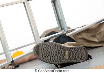 Accident with ladder - Close up of the man lying on the...