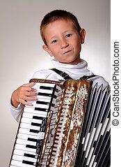 Accordion Boy - Young boy playing a 48 base accordion