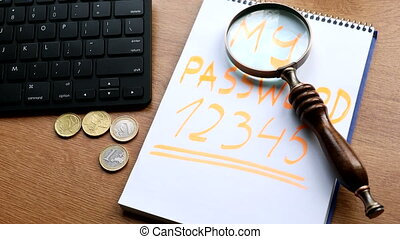 Account security concept. Password on notepad. magnifier and...