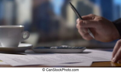 Accountant business person working on tax return forms at...