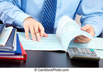 Business man working with documents in the office.