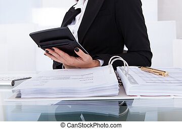 Accountant Calculating Tax