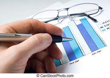Accountant - hand of accountant with bar chart and glasses