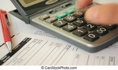 accountant hand using calculator