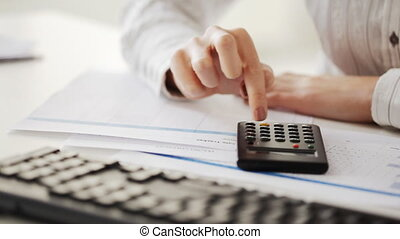 accountant making calculations and working with computer -...