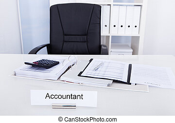 Accountant Name Plate On Desk With Empty Chair