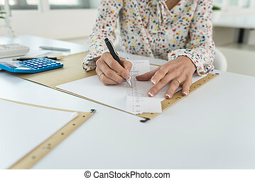 Accountant summing up the numbers writing on a printout receipt