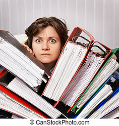 Accountant swamped with financial documents