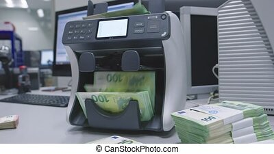 Money couner arranging euro ? cash banknotes after it is counted by the counting machine