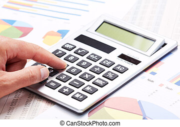 Accountant working with calculator.