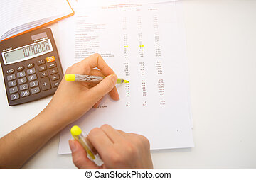 Accountant working with paperwork, reports