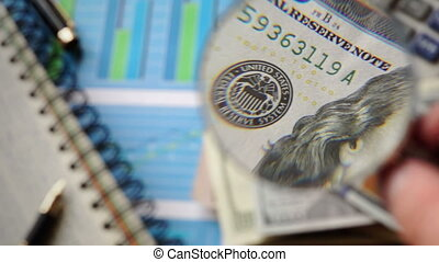 Accounting background. Hundred Dollar banknote is watched...
