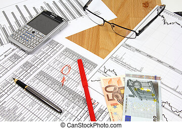 Business composition. Financial analysis - income statement, finance graphs, generic smart phone, Euro money and a fountain pen.