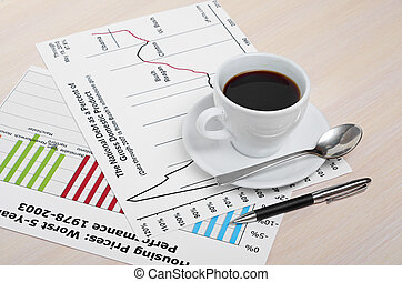 Accounting. Cup of coffee on document. chart and diagram