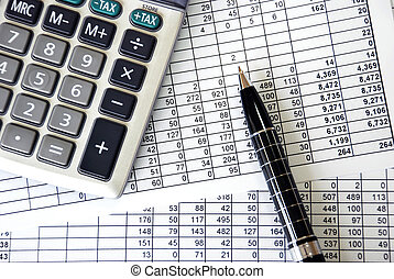 Accounting - document with numbers with silver calculator...