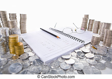 Accounting ledger between piles of coins - A book use for...