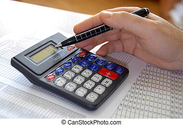 Accounting - man hand holding pen on calculator buttons in ...