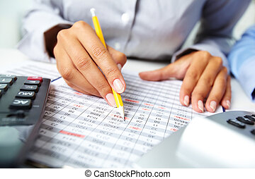 Accounting notes - Photo of human hands holding pencil and ...