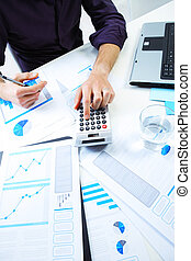 Accounting notes - Business man checking financial data on...