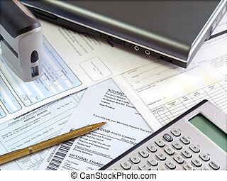 Accounting table. - Accounting tools and bills on the table.
