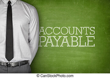 Accounts payable text on blackboard with businessman on side