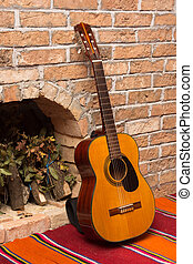 Accoustic guitar on the brick wall