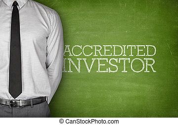 Accredited investor text on blackboard with businessman on side