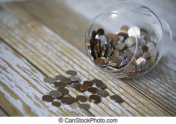 Accumulated coins stacked in glass jars
