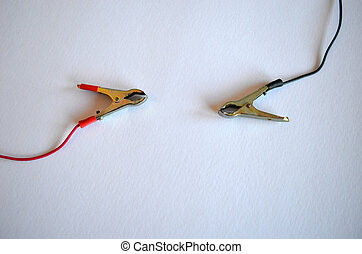 Accumulator battery charger connectors clamp. Plius and minus, red and black on white background.