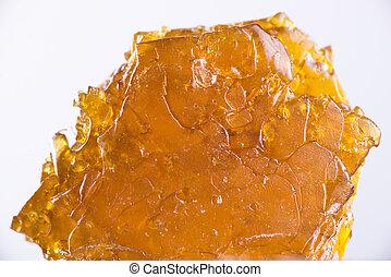 aceite, encima, fragmentos, aislado, cannabis, concentrado, plano de fondo, aka, blanco