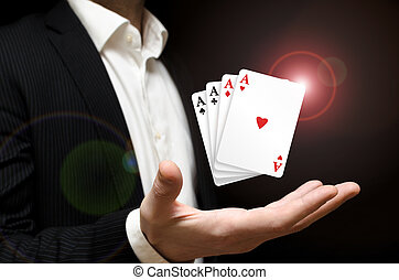 Aces - Man holding four poker aces