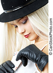 aces - pretty blond in hat with playing cards