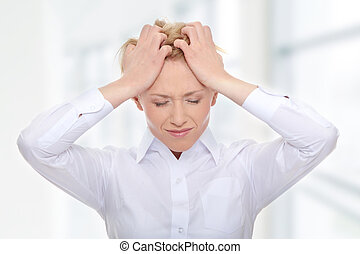 Ache - Young business woman with headache