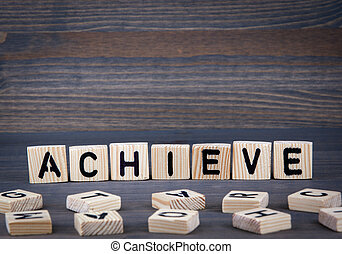 Achieve word written on wood block. Dark wood background with texture