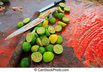 achiote knifes and lemons for achiote tikinchick sauce -...