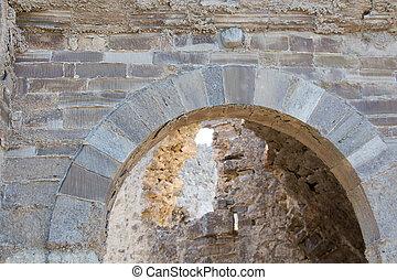 Acient stone gate's top arch detail