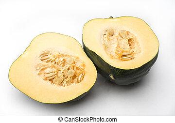 Acorn squash (Cucurbita pepo) cut in 2 with seed showing