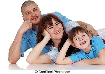 acostado, feliz, tres, familia , gente