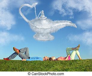 acostado, pareja, en, pasto o césped, y, sueño, alladin, lámpara, nube, collage